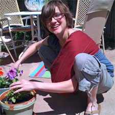 Student potting a plant
