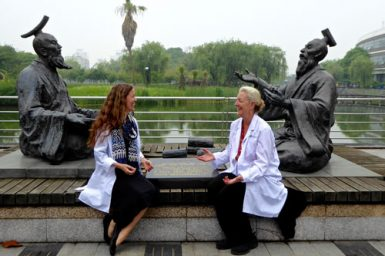 Sheila Devitt and Lesley Tierra share ideas with ancient scholars